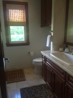 Lower bath adjacent to Twin bedroom.  Oversize sink and stone floors.