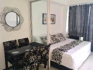 Azure Condo Unit Black and White Room