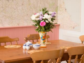 dining table with map wall behind