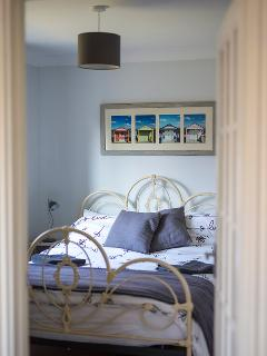 This is the main bedroom tastefully decorated with some local photos.