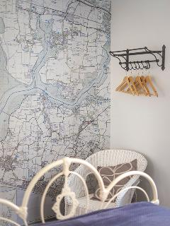 One wall of the main bedroom has a huge map of the local area as well as a place to hang your cloths