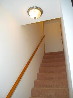 Stairs to 2nd floor bedroom are carpeted, well lit and easy to climb.