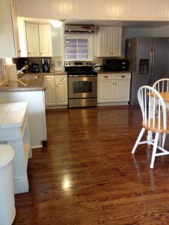 Nice kitchen with granite counters, stainless appliances and hardwood floors.