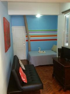 First room where you enter the apartment with TV, dressoir, double bed 140x200cm