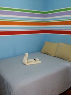 Nicely decorated apartment Bed in the first room where you enter