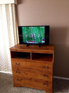 32' flat screen TV with smart DVD player in the master bedroom.