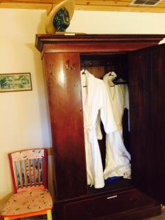 armoire with complementary terry robes