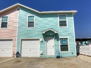 4 bedroom 3 baths, community pool and just a short walk to the beach!