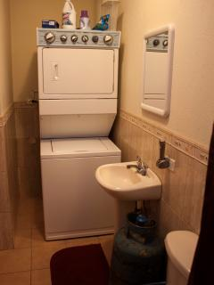 Washer dryer, laundry area.
