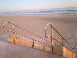 New! Beach access is across seawall from our condo.
