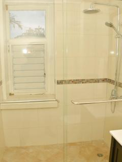 Bathroom with rainfall shower and spacious shower enclosure