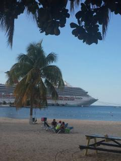 Plenty of room to relax on the beach and admire the cruise ships