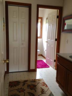 Second floor bathroom has sink in one room and shower, etc. in next.