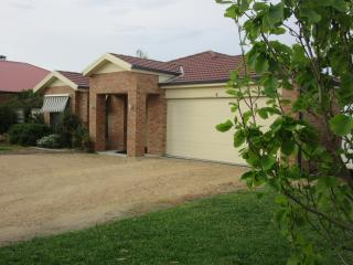 Front of our property.  Large U driveway with grassed off street parking for our guests
