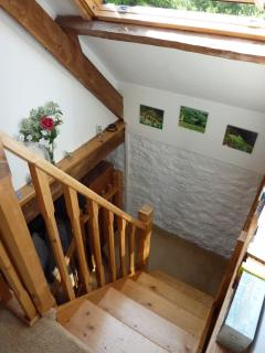 Handmade wooden staircase with large velux above.