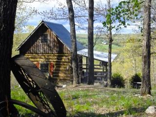 The cabin is perched on the brink of a hill overlooking the Gasconade River Valley.