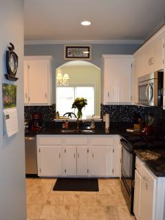 The kitchen is fully-stocked with appliances, dishes, utensils, and much more!