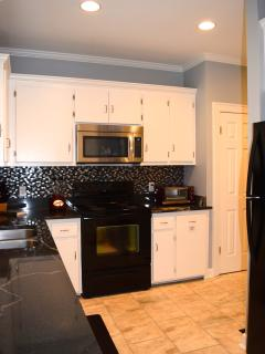 Another view of the kitchen with its unique granite slab counters