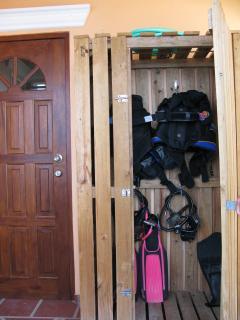 Store gear in locked dive locker, lock provided.