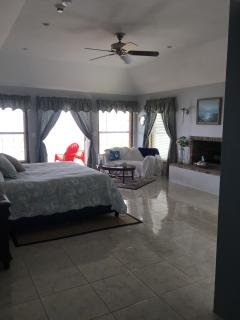 Master bedroom with fireplace opens to vast balcony and has Jacuzzi tub, walk in shower and closet.
