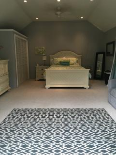Lovely large bedroom opens to private garden area ideal for reading or simply to enjoy from bed.