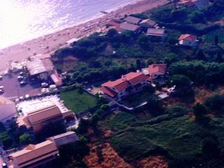 Aerial view of the property and the near by restaurant-cafe, paring and the beach
