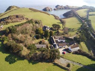 KINGFISHER COTTAGE, semi-detached, on working farm, shared private beach, in