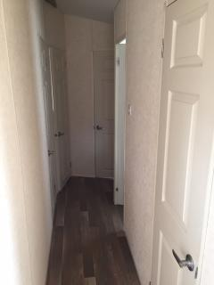 Corridor leading to bedrooms and toilet and shower room