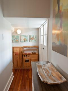 A hidden kids' area off the 2nd floor family room has a kitchen & puppet theater.