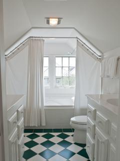 3rd floor full bath has two facing sinks, large shower/soaking bathtub