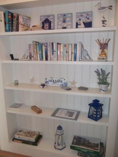 Hallway book shelf with books to browse through