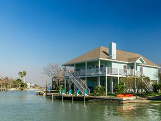 Side view showing boat ramp, lighted fishing dock and spacious balcony w/awesome views.