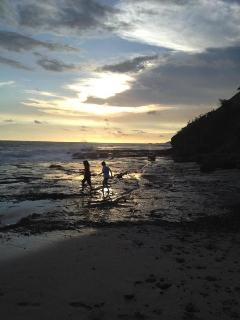 Playing in the tide pools at sunset