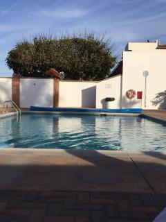 Community heated pool at only a walking distance.