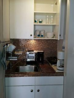 small kitchen area with fridge and microwave and much more...