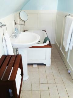 Ensuite bathroom with tub and Victorian shower handle