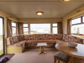 Spacious lounge area at Broadland Sands Holiday Park.
