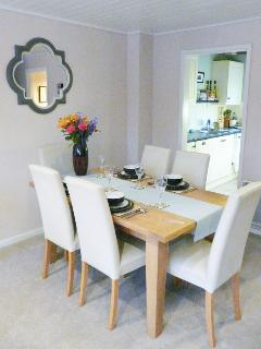 Kitchen leads to dining area with seating for 6