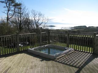 Hot tub sunk into private decking, stunning views, what more can be said?