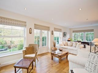 Light and airy lounge   with large windows and  french doors leading into secluded garden