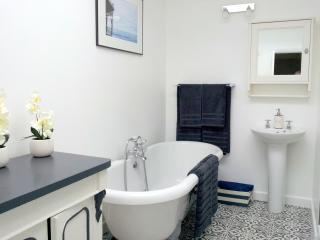 Amazing star gazing bathroom with glass ceiling,a roll top bath, separate shower, toilet and basin