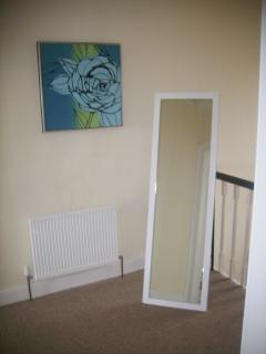 Top floor landing with full length mirror to check yourself before going out