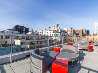 Dog-friendly downtown studio with a private patio, a shared gym & roof deck!