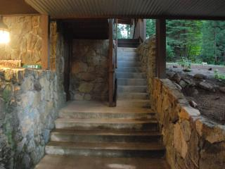 From the street you'll walk up this narrow stone staircase to the front door
