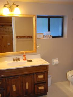 The upstairs bathroom has a shower, but no tub