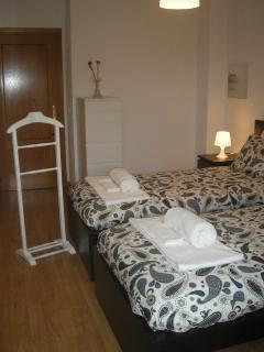 2 single beds, with wardrobe and balcony