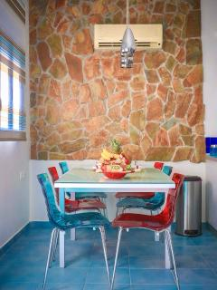 kitchen overlooking the sea and dinner-lounge table for 6