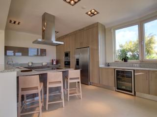 Our modern kitchen also has the views and is a bright social space.