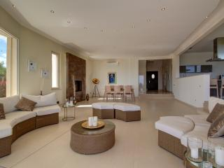 The living room, dining room and kitchen is open concept and conducive to socializing