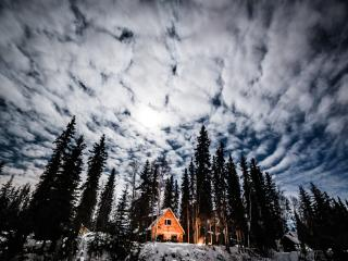 Cloudy Moonlit night over Moose Walk Cabin.